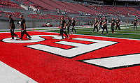Cincinnati players walk to the visitor's locker room before the start of a football game between The Ohio State Buckeyes and the University of Cincinnati Bearcats on Saturday, September 27, 2014 at Ohio Stadium in Columbus. (Columbus Dispatch photo by Fred Squillante)