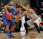 SIOUX FALLS, SD - MARCH 10:  Pierre Bland #2 of IPFW shields the ball from Duke Mondy #10 of Oakland University during their quarterfinal game at the 2013 Summit League Basketball Championships at the Sioux Falls Arena Sunday. (Photo by Dick Carlson/Inertia)