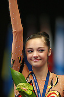 Anna Bessonova of Ukraine celebrates winning bronze in All-Around competition during at 2006 Portimao World Cup of Rhythmic Gymnastics on September 9, 2006.  (Photo by Tom Theobald)