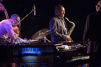 Ravi Coltrane jokes with the Ethan Iverson Trio between songs during the Monk @ 100 festival at the Durham Fruit and Produce Company in Durham, NC Thursday, October 26, 2017. (Justin Cook for The New York Times)
