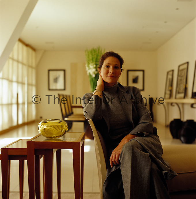 Portrait of interior designer Anne Maria Jagdfeld sitting in her living room