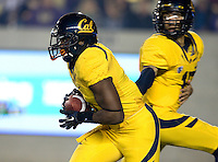 Zach Maynard of California gives the ball to C.J. Anderson during the game against Washington at Memorial Stadium in Berkeley, California on November 2nd, 2012.  Washington Huskies defeated California, 13-21.