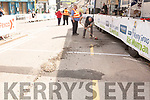 A cement lorry looses some of its concrete at the finish line and just before the start of the 10 laps of the town at the Rás Mumhan cycling in Killorglin on Easter Monday.