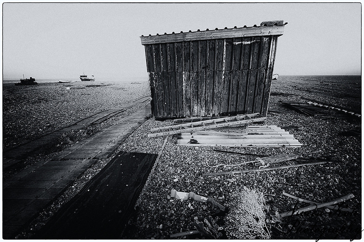 Corrugated metal hut on the shingle beach at Dungeness, Kent, United Kingdom