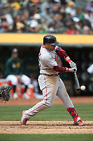 OAKLAND, CA - APRIL 4:  Steve Pearce #25 of the Boston Red Sox bats against the Oakland Athletics during the game at the Oakland Coliseum on Thursday, April 4, 2019 in Oakland, California. (Photo by Brad Mangin)
