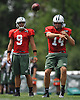 Ryan Fitzpatrick #14, New York Jets starting quarterback, right, throws a pass alongside fellow signal caller #9 Bryce Petty during training camp at Atlantic Health Jets Training Center in Florham Park, NJ on Wednesday, Aug. 17, 2016.