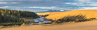 Panorama of two hikers along the Ahnewetut Creek, Great Kobuk Sand Dunes in the Kobuk Valley National Park, Arctic, Alaska.