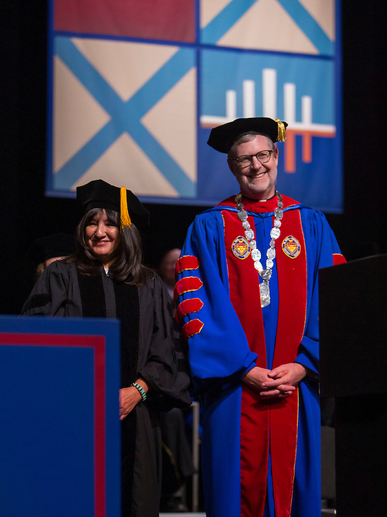 Sandra Cisneros, writer and community activist, shares a laugh with the Rev. Dennis H. Holtschneider, C.M., president of DePaul University, as she is presented for her honorary degree. Students from DePaul University School for New Learning graduated during the 116th commencement ceremonies on Saturday, June 14, 2014, at the Rosemont Theater. (DePaul University/Jeff Carrion)