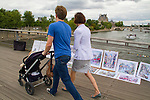 French family walking over the Seine River, Paris, France,