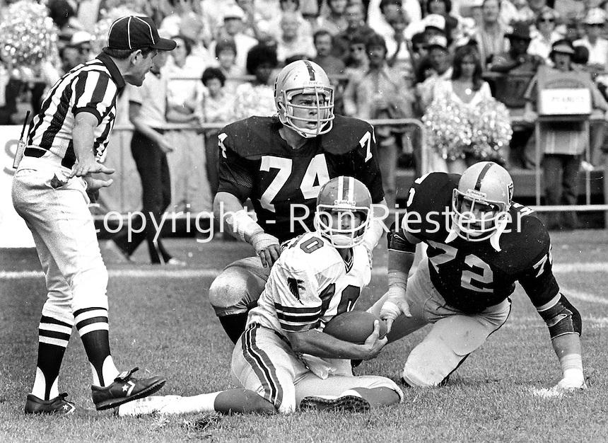 Atlanta Falcons QB Stever Bartkowski is sacked by Raiders Dave Pear and John Matuszak. (1979 photo/Ron Riesterer)