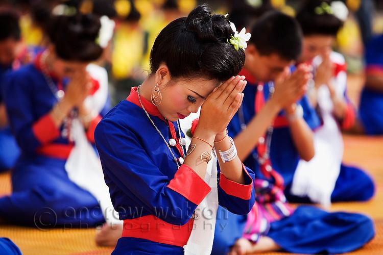 Dancers in traditional Isan dress gather in front of Wat Phra That Phanom in That Phanom during the festival of Ok Phansa.  That Phanom, Nakhon Phanom, THAILAND
