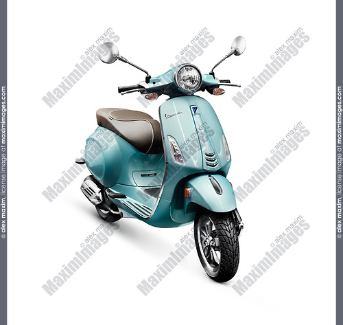 Blue 2017 motor scooter Vespa manufactured by Piaggio isolated on white background with clipping path
