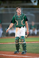 Dartmouth Big Green catcher Bennett McCaskill (18) looks on as first baseman Michael Calamari (not shown) catches a ball in foul territory during a game against the Northeastern Huskies on March 3, 2018 at North Charlotte Regional Park in Port Charlotte, Florida.  Northeastern defeated Dartmouth 10-8.  (Mike Janes/Four Seam Images)