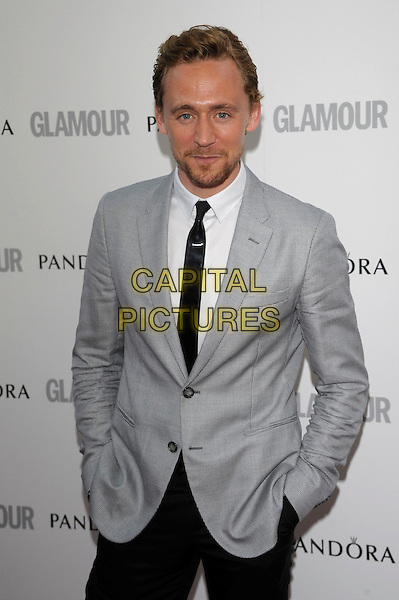 Tom Hiddleton.Women Of The Year 2012 - Glamour Awards, Berkeley Square, London, England..29th May 2012.half length grey gray suit jacket black tie white shirt goatee facial hair hand sin pockets .CAP/PL.©Phil Loftus/Capital Pictures.
