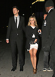 ...November 14th 2011  ..Ashley Tisdale holding hands with her boyfriend Scott Speer as they left the Twilight Movie premeiere in Los Angeles. Ashley was  carrying a  Black designer Chanel purse lace white dress skirt cheetah leopard shoes. ...AbilityFilms@yahoo.com.805-427-3519.www.AbilityFilms.com.
