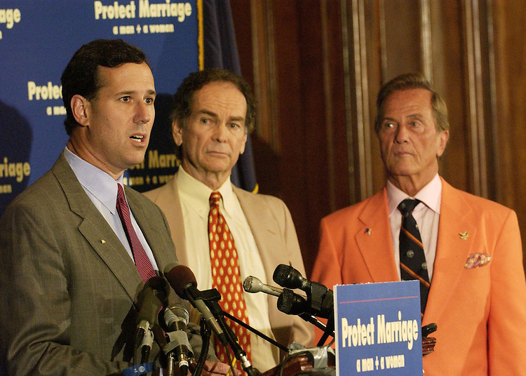 7/13/04.FEDERAL MARRIAGE AMENDMENT--Sen. Rick Santorum, R-Pa., with actor Dean Jones, and recording artist Pat Boone, during a news conference on the marriage amendment, which defines marriage as only between one man and one woman, being debated in the Senate..CONGRESSIONAL QUARTERLY PHOTO BY SCOTT J. FERRELL.
