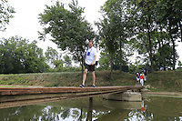 Photographer Paul Childs crosses the footbridge from the 9th tee during Thursday's Round 1 of the 2014 PGA Championship held at the Valhalla Club, Louisville, Kentucky.: Picture Eoin Clarke, www.golffile.ie: 6th August 2014