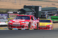 Jun. 21, 2009; Sonoma, CA, USA; NASCAR Sprint Cup Series driver Juan Pablo Montoya (42) leads Kevin Harvick during the SaveMart 350 at Infineon Raceway. Mandatory Credit: Mark J. Rebilas-