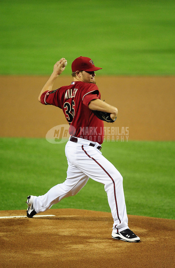 May 9, 2012; Phoenix, AZ, USA; Arizona Diamondbacks pitcher Wade Miley winds up for the pitch during the game against the St. Louis Cardinals at Chase Field. The Cardinals defeated the Diamondbacks 7-2. Mandatory Credit: Mark J. Rebilas-