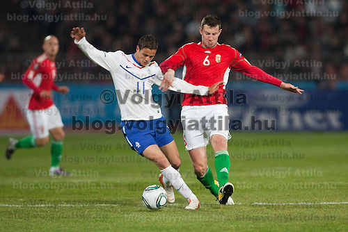 Hungary's Akos Elek (R) and Nederland's Ibrahim Afellay (L) fights for the ball during a European Championships preliminaray game in Budapest, Hungary on March 25, 2011. ATTILA VOLGYI