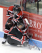 Katie MacSorley (Northeastern - 3), Rachel Llanes (Northeastern - 11) - The Boston University Terriers defeated the visiting Northeastern University Huskies 3-2 on Saturday, January 28, 2012, at Agganis Arena in Boston, Massachusetts.