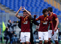 Calcio, Serie A: Roma-Genoa. Roma, stadio Olimpico, 12 gennaio 2014.<br /> AS Roma midfielder Alessandro Florenzi, left, celebrates with teammates after scoring during the Italian Serie A football match between AS Roma and Genoa, at Rome's Olympic stadium, 12 January 2014. <br /> UPDATE IMAGES PRESS/Isabella Bonotto