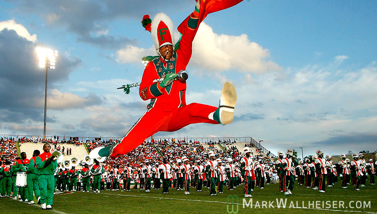 Grad student and one of nine drum majors in the FAMU Marching 100 takes a flying leap to land in a split to start the band before a home Florida A&M football game.