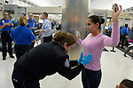 Mirna Vasquez, a refugee from El Salvador, is searched by a TSA official in the airport in San Antonio, Texas, on December 2, 2015. She fled El Salvador with her daughter to escape gang-related violence. After requesting political asylum in the United States, they were held for several days by immigration officials and then released, although she wears an ankle monitors. They stayed briefly in a shelter run by the Refugee and Immigrant Center for Education and Legal Services (RAICES) and supported by a coalition of San Antonio churches, then flew to another location in the U.S. while they await final decisions on their asylum petition.