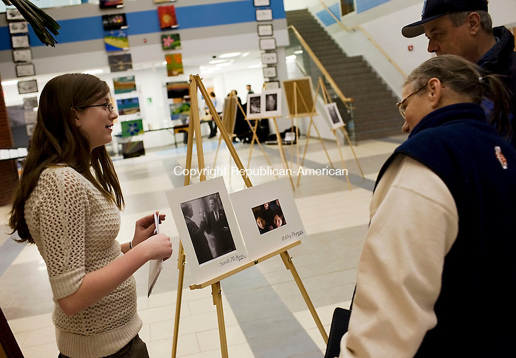 OXFORD--24January 07--012408TJ11 - Sarah McKane, 15, left, talks with Dottie DeBisschop and her husband Bob, from Oxford, about her photograph on display at the Fine Arts Winter Festival at Oxford High School on Thursday, January 24, 2008. (T.J. Kirkpatrick/Republican-American)