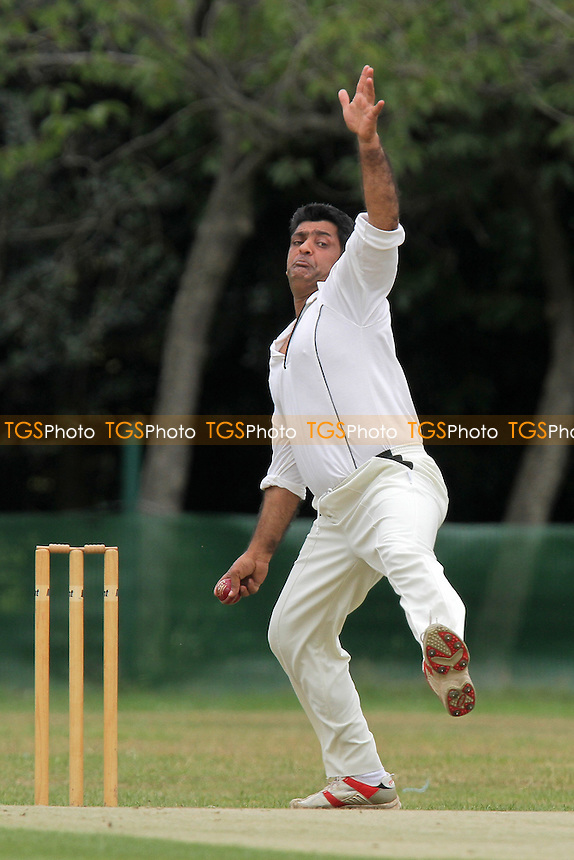 N Abbas in bowling action for Ilford - Ilford CC (fielding) vs Loughton CC - Essex Cricket League - 06/08/11 - MANDATORY CREDIT: Gavin Ellis/TGSPHOTO - Self billing applies where appropriate - 0845 094 6026 - contact@tgsphoto.co.uk - NO UNPAID USE.