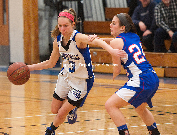 BURLINGTON, CT-013114JS07- Lewis Mills' Ailene Berry (3) drives around Nonnewaug's Alex Eanniello  (24) during their game Friday night at Lewis S. Mills High School in Burlington.  Jim Shannon Republican-American