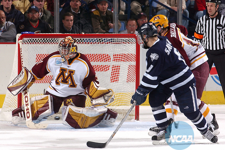12 APR 2003:  Goalie Travis Weber (31) of the University of Minnesota makes a save against Steve Saviano (8) of the University of New Hampshire during the Division 1 Men's Ice Hockey Championship held at the HSBC Arena in Buffalo, NY.  Minnesota defeated New Hampshire 5-1 for the national title.  ©NCAA Photos