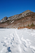 Eagle Cliff from Profile Lake in Franconia Notch State Park of the New Hampshire White Mountains during the winter months.