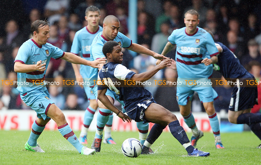 Gavin Tomlin of Southend is challenged by Winston Reid of West Ham - Southend United vs West Ham United, Pre-season Friendly at Roots Hall, Southend - 14/07/12 - MANDATORY CREDIT: Rob Newell/TGSPHOTO - Self billing applies where appropriate - 0845 094 6026 - contact@tgsphoto.co.uk - NO UNPAID USE..
