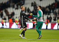 28th December 2019; London Stadium, London, England; English Premier League Football, West Ham United versus Leicester City; Goalkeeper Lukasz Fabianski of West Ham United congratulates Goalkeeper Kasper Schmeichel of Leicester City after the final whistle - Strictly Editorial Use Only. No use with unauthorized audio, video, data, fixture lists, club/league logos or 'live' services. Online in-match use limited to 120 images, no video emulation. No use in betting, games or single club/league/player publications