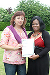 Tutor Dara Larkin presents Angela Ugwuja with her FETAC certificate for computer literacy at the presentation of certificates to successful participants of the Home School and Community Liaison Course....Photo NEWSFILE/Jenny Matthews.(Photo credit should read Jenny Matthews/NEWSFILE)....This Picture has been sent you under the condtions enclosed by:.Newsfile Ltd..The Studio,.Millmount Abbey,.Drogheda,.Co Meath..Ireland..Tel: +353(0)41-9871240.Fax: +353(0)41-9871260.GSM: +353(0)86-2500958.email: pictures@newsfile.ie.www.newsfile.ie.FTP: 193.120.102.198.