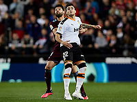1st February 2020; Mestalla, Valencia, Spain; La Liga Football,Valencia versus Celta Vigo; Maxi Gomez of Valencia CF challenges for a high ball with defender Nestor Araujo of Celta