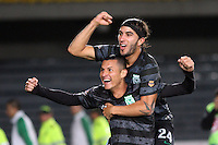 BOGOTA -COLOMBIA, 1 -SEPTIEMBRE-2014. Luis Paez  (Abajo) de Atletico Nacional celebra su gol con Sebastian Perez (arriba) contra La Equidad Seguros durante partido de la  septima  fecha  de La Liga Postobón 2014-2. Estadio Nemesio Camacho El Campin . / Luis Paez (Down)  and Sebastian Perez (Up)  of Atletico Nacional   celebrate his goal against the  Equidad F.C.    during match of the 7th date of Postobon  League 2014-2. El Campin  Stadium. Photo: VizzorImage / Felipe Caicedo / Staff