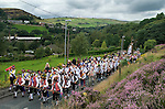 Saddleworth rushcart near Delph, Yorkshire UK. Morris men and Saddleworth Rushcart being taken to Dobcross.