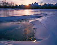 Sunset light on an ice field on Spread Creek along the Snake River; Grand Teton National Park, WY