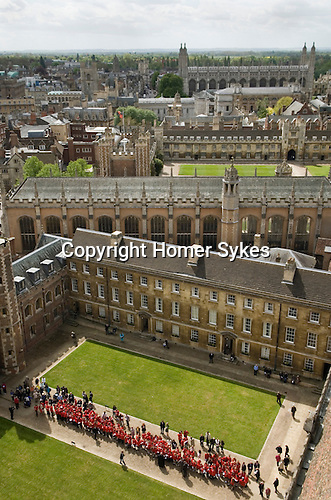 Cambridge University UK.  Ascension Day. Students from St Johns College Choir School dressed in red, line up to hear the College Choir singing from the roof of  St Johns College Chapel at 12 noon annually.
