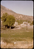 Steel through-truss bridges across Animas River at Durango viewed from the D&amp;RGW yards - D&amp;RGW on left and Highway 160 on right.  The track in the foreground is the route to the Graden Flour Mill and the turning loop.<br /> D&amp;RGW  Durango, CO  ca. 1950