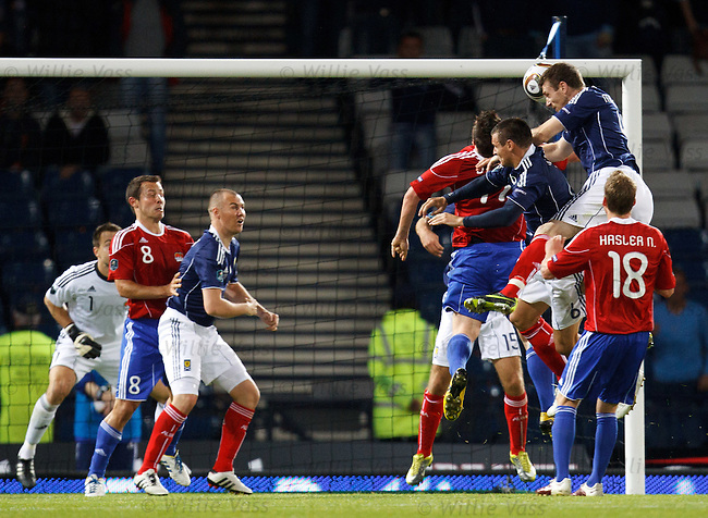 Stephen McManus rises to score the last gasp winner for Scotland