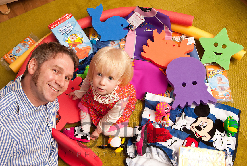 Young Florence Cuthbert isn't quite two, but she was pleased to receive an early birthday present in the shape of a pile of swimming goodies from Computershare Voucher Services. Florence is pictured with her dad Jeremy.