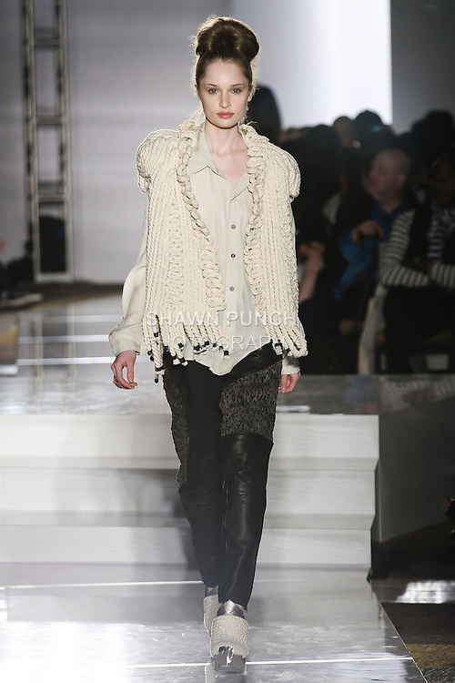Model walks runway in an outfit by Joanna Akkaoui, for the Parsons 2011 BFA Fashion Show, hosted by Reed Krakoff.