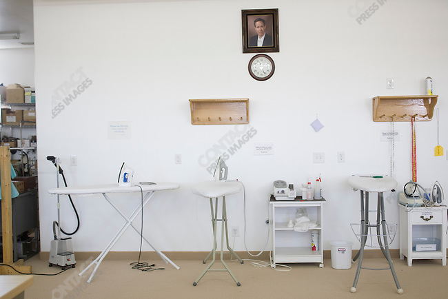 Fundamentalist Mormon group F.L.D.S., portrait of church leader Warren Jeffs hanging in the storehouse where they use sewing machines to make dresses and clothes. Compound in Eldorado, Texas, USA, February 12, 2009