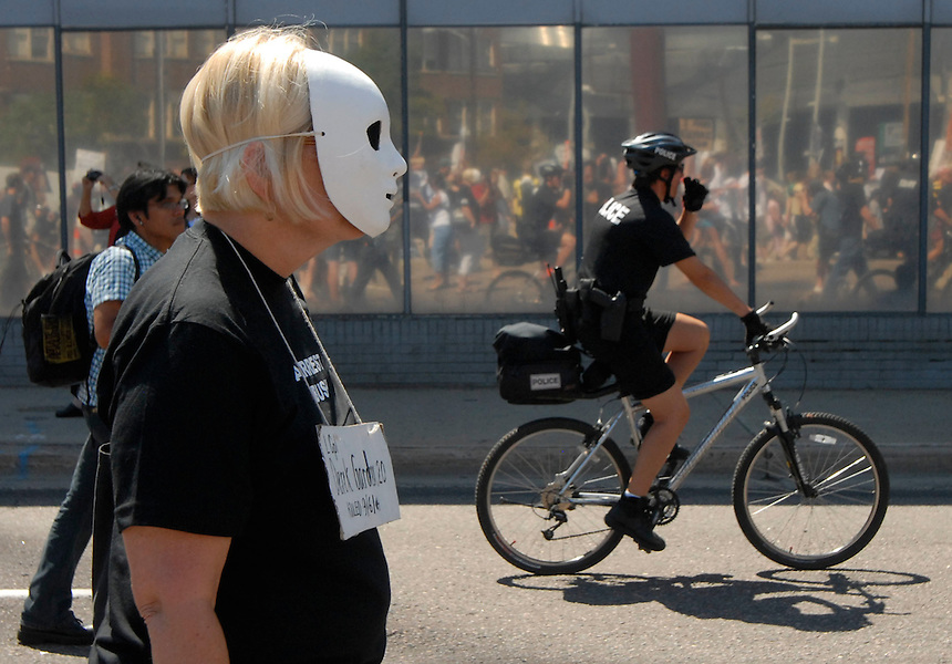 24 Aug 08: Protesters are escorted by inter-agency police personnel during an organized march from the Colorado state capitol building to the Pepsi Center. On the day before the Democratic National Convention is scheduled to begin about 1,500 people participated in the ReCreate 68 rally, which included a march from the Colorado state capitol building to the Pepsi Center.