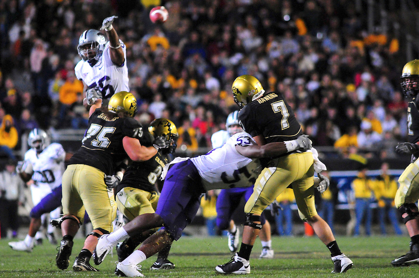 18 October 08: Colorado quarterback Cody Hawkins (7) is tackled by Kansas State linebacker Reggie Walker (53) as his pass is blocked by safety Andrew Erker (36). The Colorado Buffaloes defeated the Kansas State Wildcats 14-13 at Folsom Field in Boulder, Colorado.