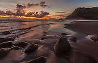 The sun rises over Pololu Valley, North Kohala, Big Island of Hawai'i.