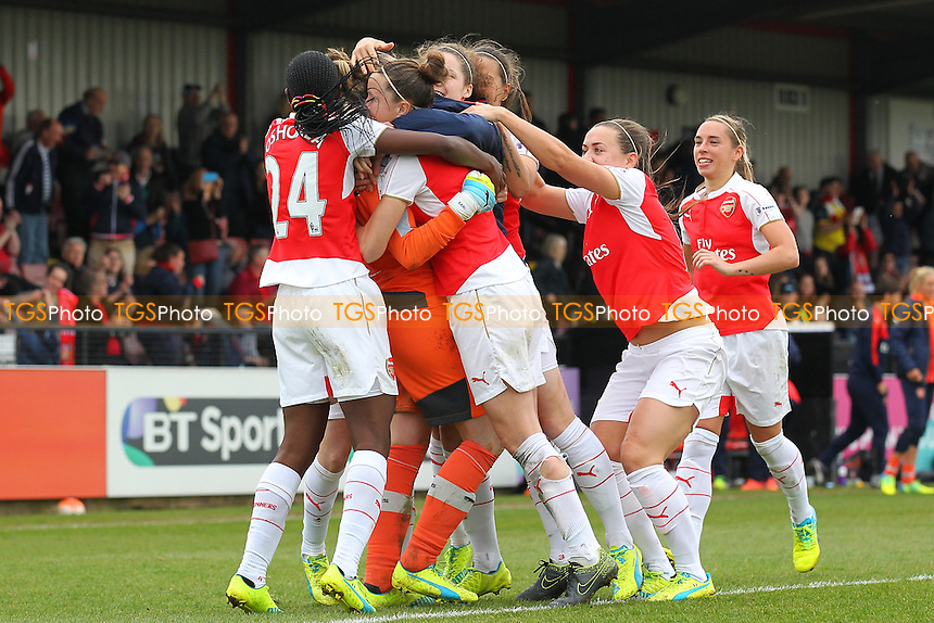 Sari van Veenendaal of Arsenal is mobbed by her team mates after her saves in the penalty shoot-out during Arsenal Ladies vs Notts County Ladies, SSE Women's FA Cup Football at Meadow Park on 3rd April 2016